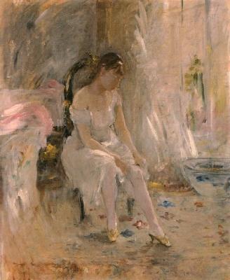 《服を着る女性