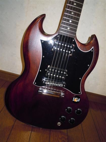 方 貼り 弦 ギター の